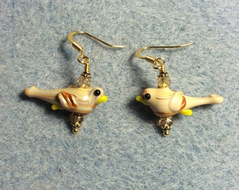 Small tan lampwork songbird bead earrings adorned with tan Chinese crystal beads.