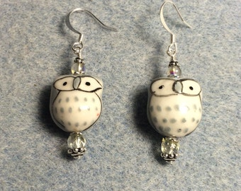 Grey ceramic owl bead earrings adorned with grey Czech glass beads.