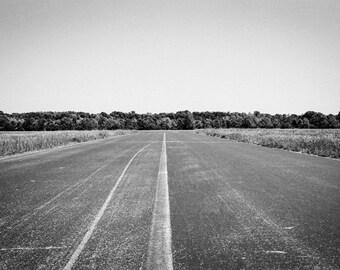 B/W print. Deserted runway