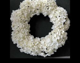 White spring/summer hydrangea wreath with accent leaves