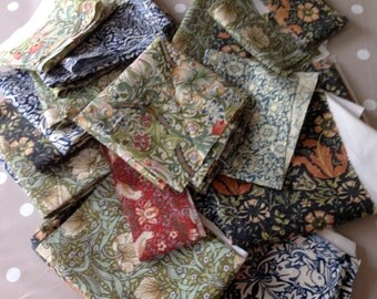 Fabric scraps, cottons with various William Morris prints
