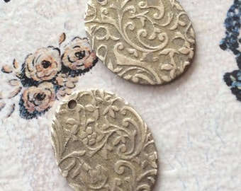 Gold patina brass embossed oval pendants 2pc.