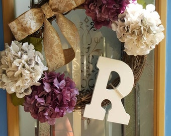 Monogrammed grapevine wreath with bow