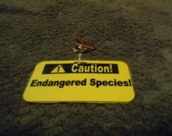 "Caution badge - ""Endangered Specied!"""