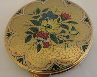 Round vintage compact, flower decoration.