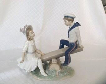 Vintage Lladro Seesaw porcelain figurine glazed #1255 children boy girl kids on seesaw playing playground porcelain figurine statue