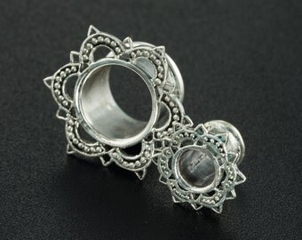 Sterling Silver tunnels. 0g tunnels. lotus plugs. gauges silver. lotus tunnels. plugs gauges. 0g gauges. silver ear tunnels. flesh tunnels.