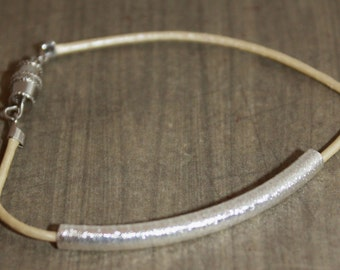 Shiny cream cord and silver bracelet