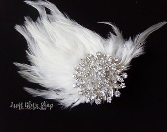 Feather pad hair accessory, hair accessory, white feathers, large rhinestone embellishment.