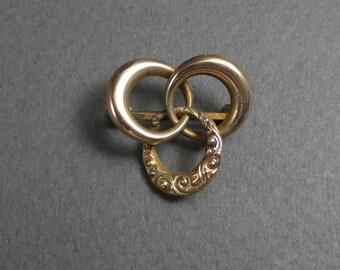 10K Victorian small 3 ring brooch
