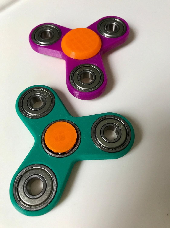 how to fix a fidget spinner cap