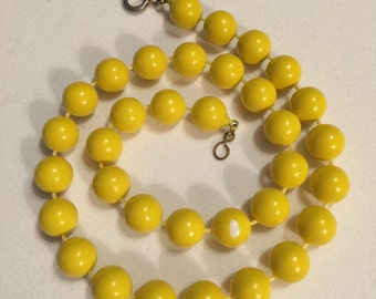 Yellow painted plastic beaded necklace
