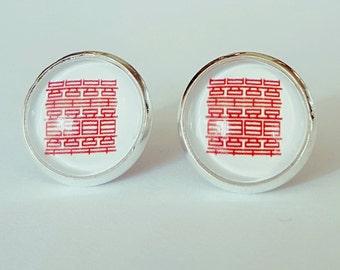 Oriental glass cabochon silver stud earrings.