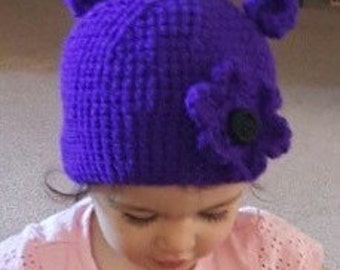 Childs beanie. You pick color/with or without ears/flower. Please specify head diameter or childs age.