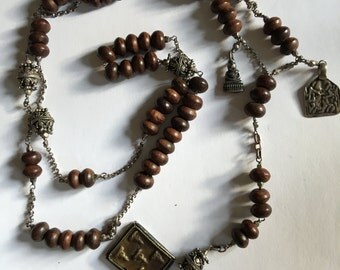 Wood Rosary strung with Sterling Silver Chain and Tibetan Charms