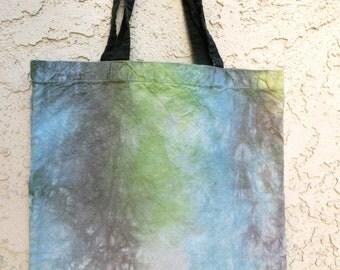 E18 tote blue black green striped tie-dye bag