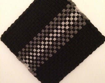 Large black, pewter, and light grey potholder