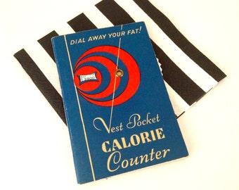 """Vintage 1940s """"Dial away your fat!"""" Vest pocket calorie counter."""
