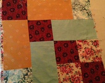 17 inch QUILT BLOCK.  Floral, barn red, gold, roses, green