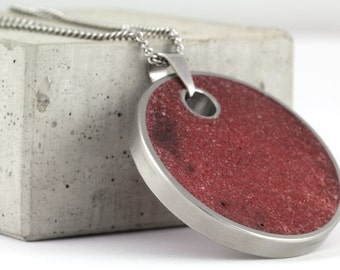 Large, red, concrete pendant with necklace