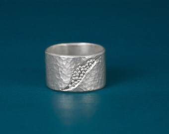 sterling silver wide hammered band ring