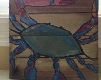 Hand-painted blue crab on wood sign