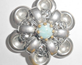 Pretty vintage silvertone flower brooch with turquoise colored plastic inset