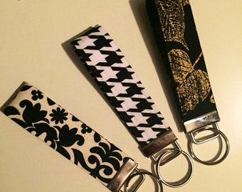 Key Fob, Key Chain, Wristlet in black and golds