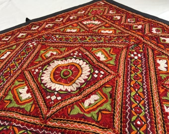 Hand embroidered wall tapestry - vibrant with mirror work on red from Kutch India