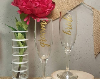 Toasting flutes bride and groom