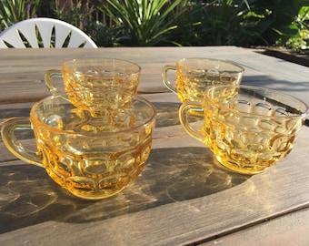 Vintage midcentury amber glass dinnerware set in thumbprint pattern