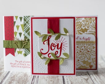 Christmas cards, glitter, hand embossed paper, hand stamped cards, some Stampin Up! products. Perfect for anyone during the holiday season!