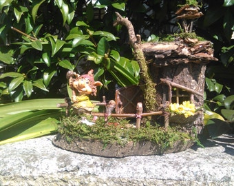 cottage with GNOME who adjust the fence