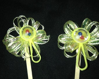 Yellow rattle cupcake toppers