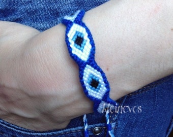 Greek Evil Eye knotted bracelet in blue and white, size medium with big pupil