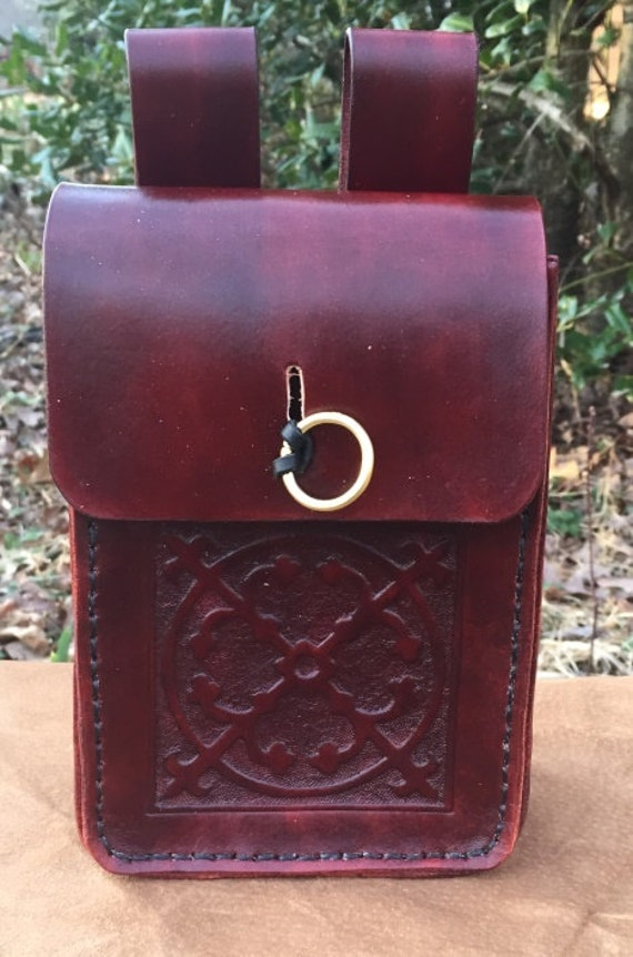 tooled leather belt pouch with floral pattern and ring