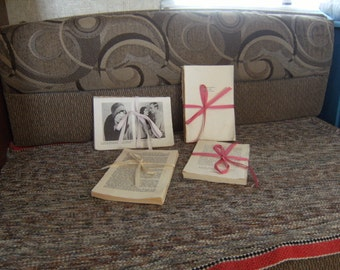 Book pages tied with ribbon