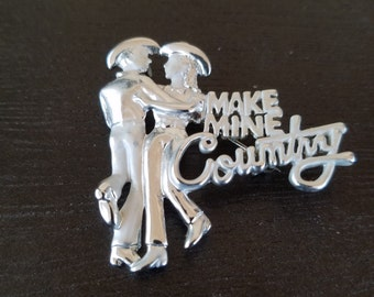 Country western two stepping brooch. Cowboy cowgirl. Signed D