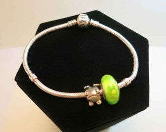 authentic pandora sterling bracelet with frog charm