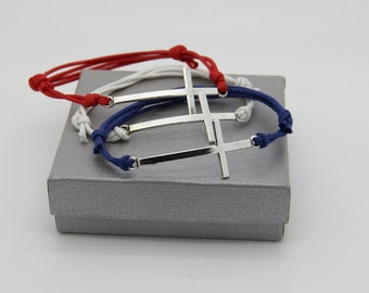 Cross and adjustable cord bracelet
