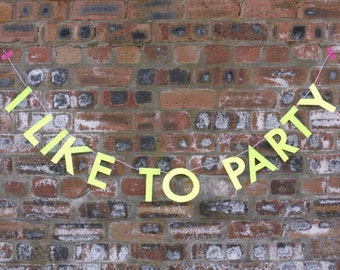 Party banner I LIKE TO PARTY letter banner - birthday party paper garland in neon yellow.