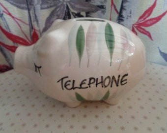 Vintage Mid Century  Retro Kitsch Telephone piggy bank with a hand painted leaf design.