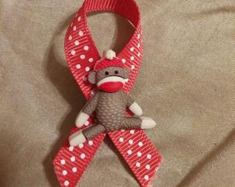 Sock monkey ribbon pin