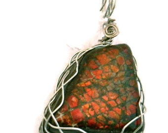Red Ammolite Pendants - elegant and classic rare gemstones from Alberta. Free form cabochon. Powerful Feng Shui gemstone.