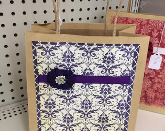 pretty vintage handmade gift bag,purple demask print, accented with a purple flower and purple grosgrain ribbon
