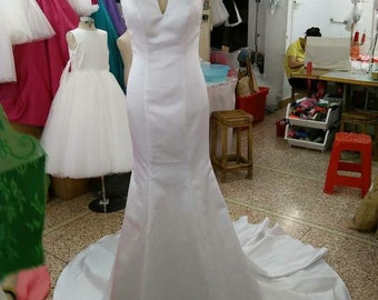 White bridal gown with deep v back
