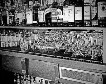 1800's saloon photo, fine art photo, black and white photograph, antique photography, bar scene, wine glasses, vintage, alcohol, rustic