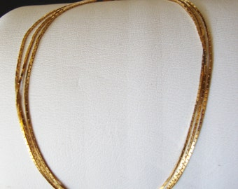 14K Gold Stamped, Made in Italy, Three Strands Linked Bracelet.