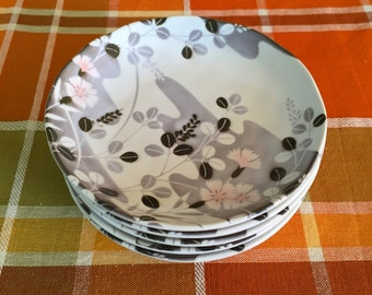 Five small Japanese plates with botanical motif