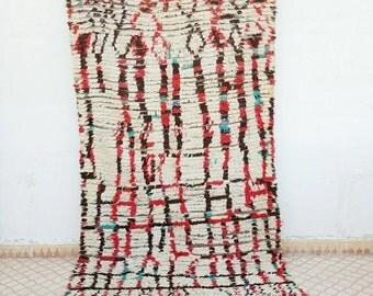Antique carpet azilal with wierd pattern